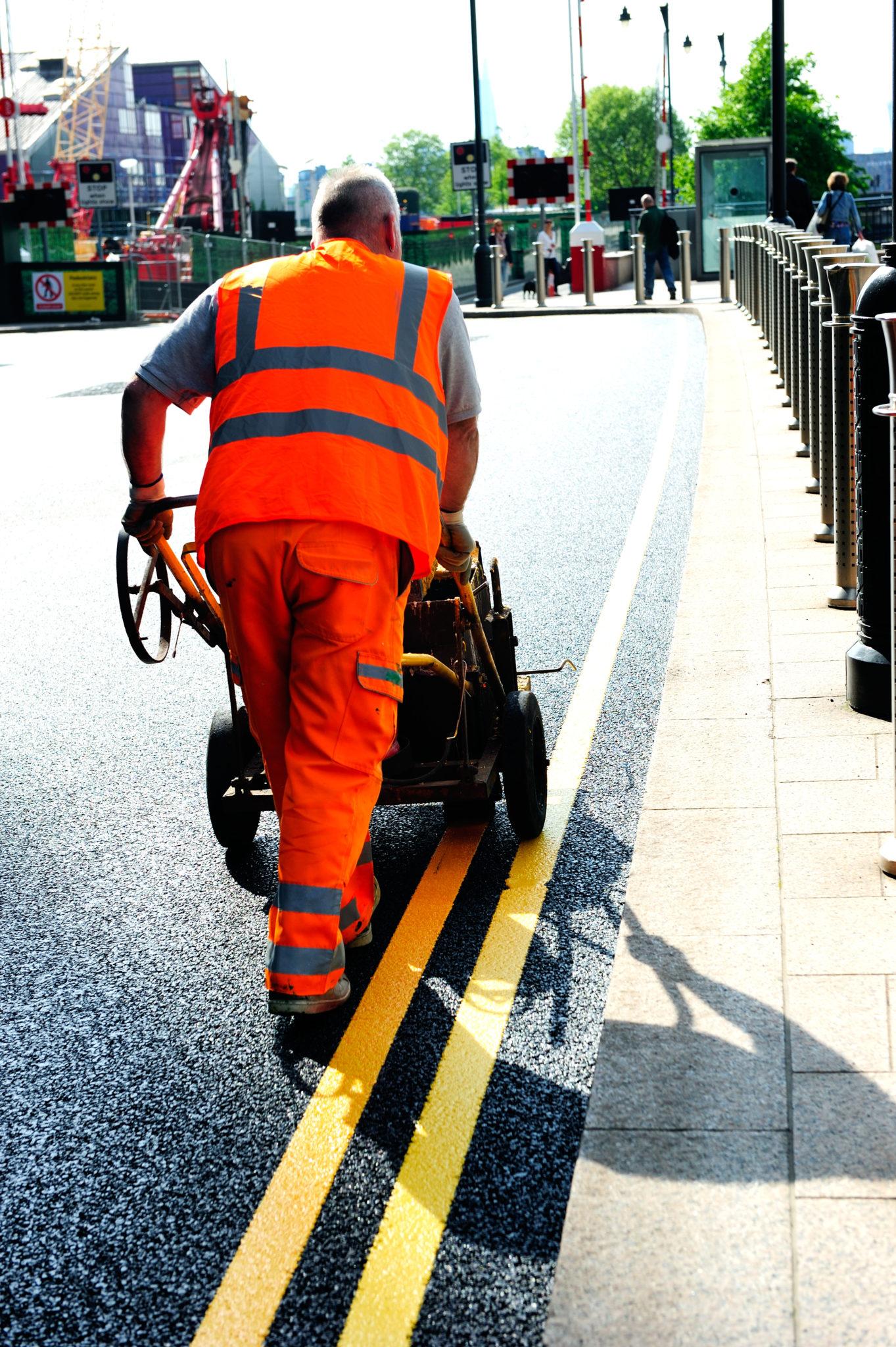Man repairing road
